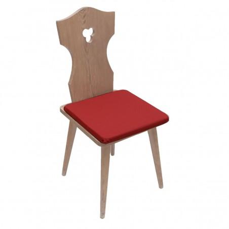 Sitzkissen Fanni in rot uni auf einem Stuhl