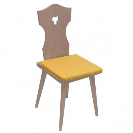 Sitzkissen Fanni in gelb uni mit Füllung auf einem Stuhl