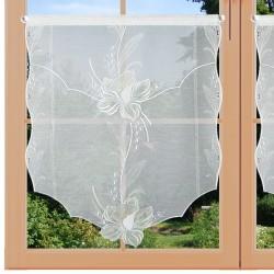 Scheibenhänger Blüte in Beige am Fenster